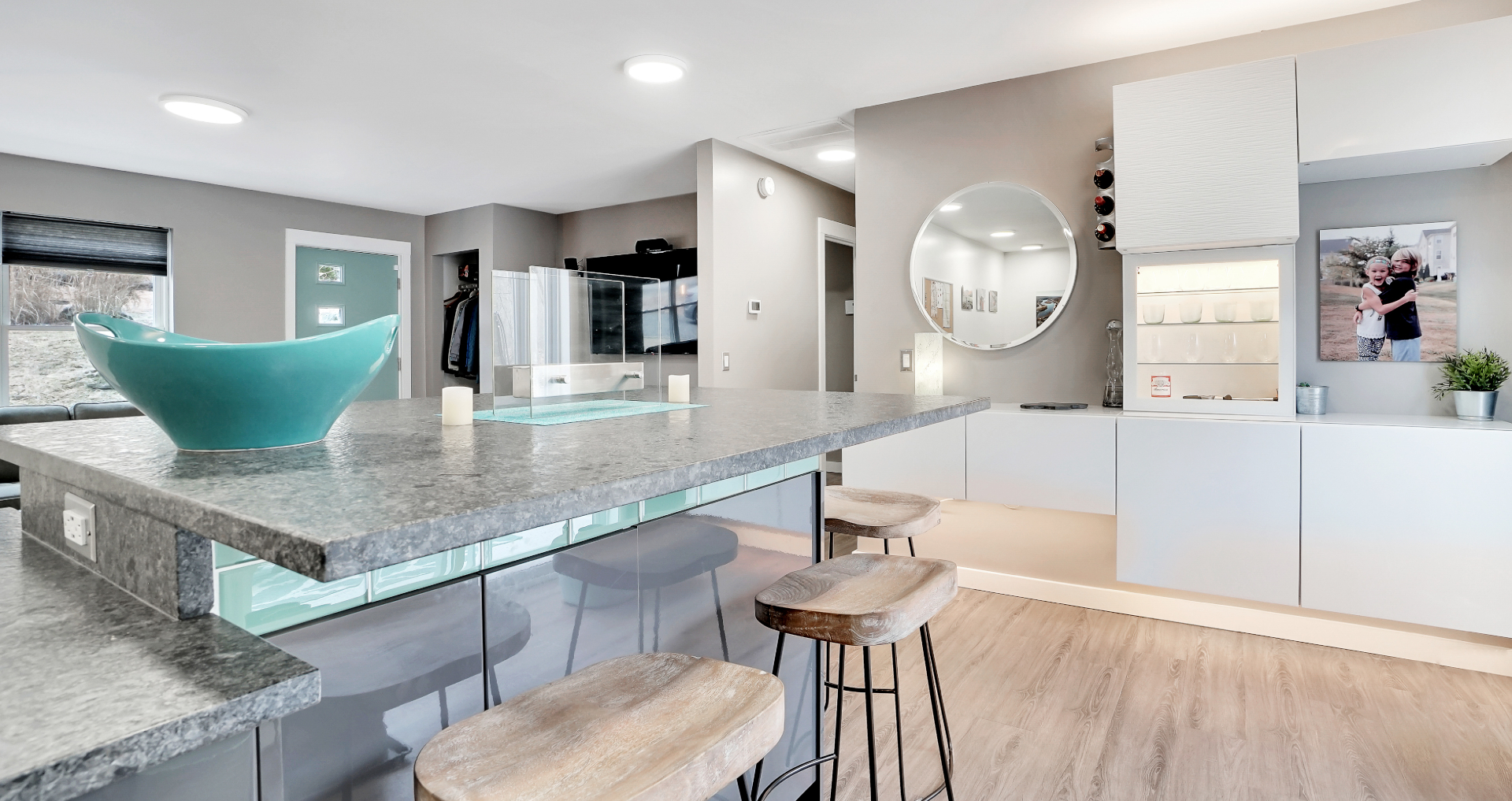 A photo of a modern kitchen with wooden floors